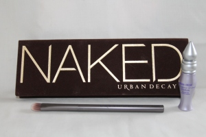 Naked Pallet with a good karma brush and a trial size primer potion, both gifts when you purchase the pallet.